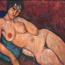 Гола жена върху синя възглавница