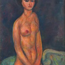 Седнала гола жена